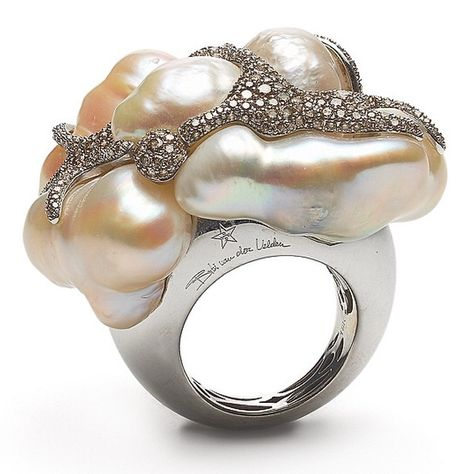 Ring that reflects the perfect summer day, liquid metallic waves with…