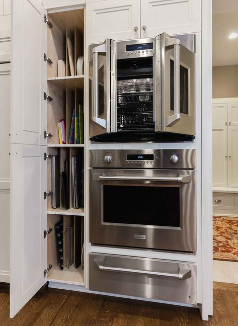 side swing french door double oven and double high cookie sheet storage cabinet in West Des Moines Clive kitchen remodeler Silent Rivers