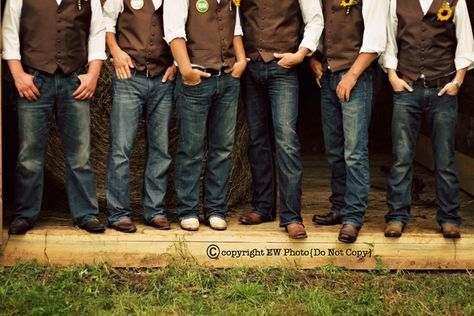 Jeans and vests.