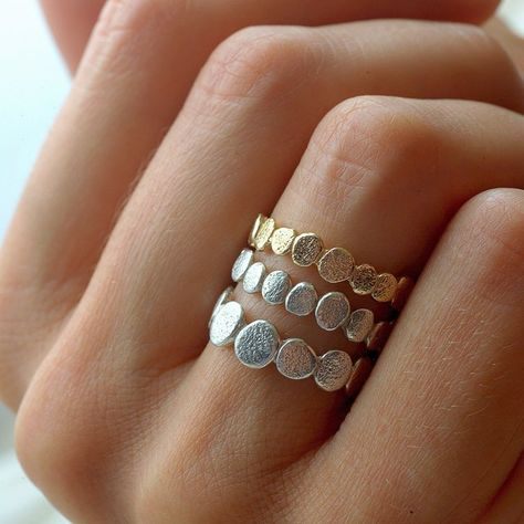 There are two pebble size. The gold pebble shown is the small pebble ring. Approximate width- These intricate rings are Inspired from the organic shapes and textures of stacked river rocks. Also available in: rose gold: