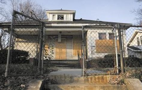 Abandoned House Boarded Up Windows And Metal Fences Research For
