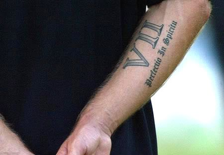 "David Beckham · David got his lucky number seven in roman numerals (VII) on his right arm. It was his shirt number for Manchester United and England. He also got a latin text that says ""Perfectio in."