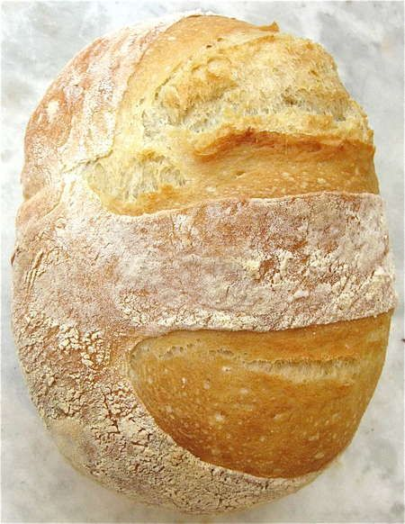 """No-Knead Crusty White Bread. """"The crunchiest-crackliest-chewiest-lightest-EASIEST bread you'll ever bake. Flour. Water. SAF yeast. Salt. That's all it takes to make the crackly-crusted, chewy, light-textured, DELICIOUS bread pictured. Just stir up a bucket of dough, and stick it in the fridge. That's right, stir; no need to knead. Want some bread? Grab a handful of chilled dough, plop it onto a piece of parchment. Let it rise. Bake it to golden perfection.""""  from kingarthurflour.com/blog"""