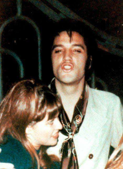 Elvis Presley and fan Sandi Miller photographed at the gate to his ...