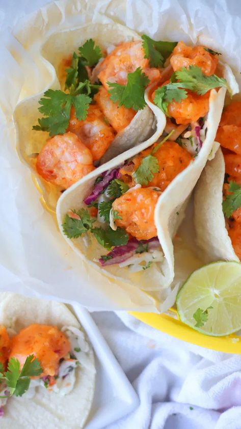 This Bang Bang Shrimp Tacos will definitely give you a bang for your tastebuds! Crispy fried shrimp covered in a sweet and spicy chili sauce is a perfect addition to your Taco Tuesday table! #tacotuesday #tacos #shrimp #sweet #spicy #sweetandspicy
