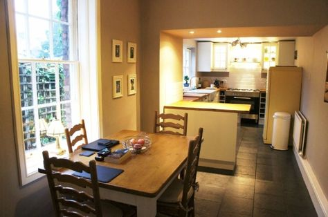 Cute Kitchen With Adjoining Dining Space