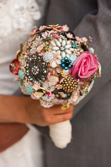 Brides on a Budget: 10 Tricks Bedazzled Bouquet Some floral wedding bouquets can cost up to $400!  For this cool idea, hot-glue vintage costume jewelry on a fabric-covered Styrofoam ball. Insert a short dowel in the bottom and wrap with fabric and ribbon to cover.