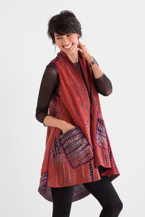Serpent Vest by Mieko Mintz . This exquisite reversible vest wows with its vivid coloration. One side has a reticulated pattern created using shibori hand dyeing, while the other side features a subtle ombré gradient. Traditional kantha quilting and all-over embroidery add stunning detail.