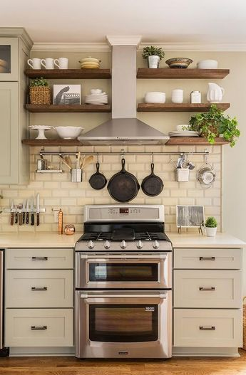 Light Gray Kitchen Cabinets Are Paired With Cream Quartz