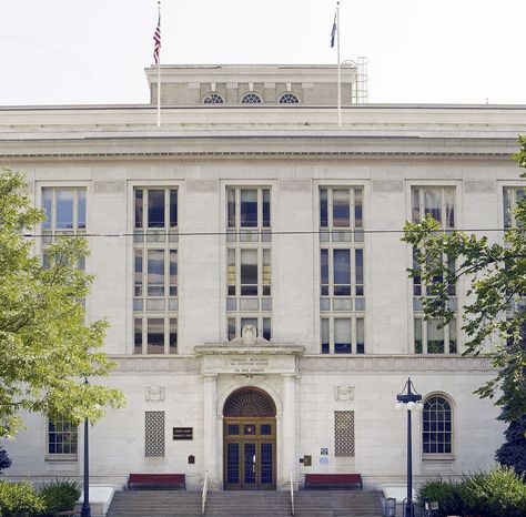 U.S. Customs House: The Federal Building and US Custom House in downtown Denver was originally completed in 1931, with an addition completed in 1937. There is an elaborate marble surround at the main entry on the 19th Street facade with engaged columns on both sides and a carved eagle at the keystone. The three entry doors are bronze with leaded glass lights and bronze leaded glass transoms above. There is a decorative bronze fan located above the doors.