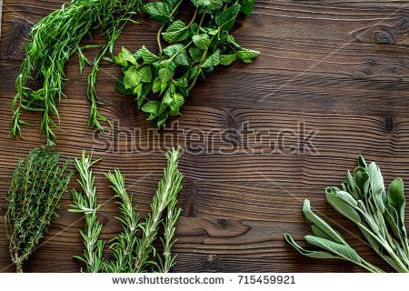 Making Spices With Fresh Herbs And Greenery For Cooking Wooden
