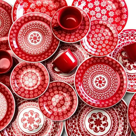 Red cups, saucers, prints.