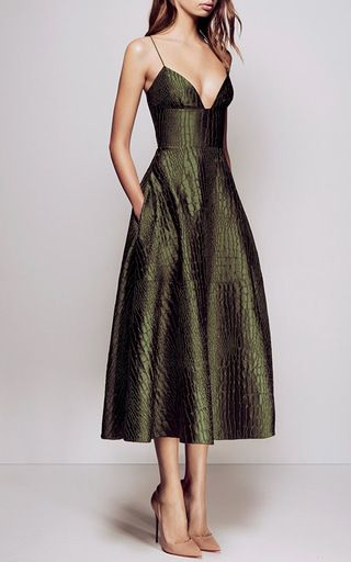 This **Alex Perry** dress features an allover silk reptile print and deep-v neckline.