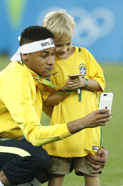 Brazil's forward Neymar takes a selfie with his son after the Rio 2016 Olympic…