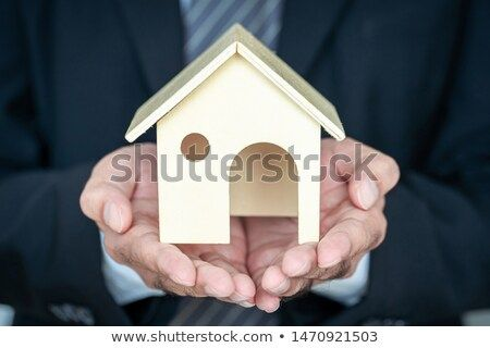 Stock Photo Businessman Hand Holding A Model Home Presenting On White Background Saving Money For Buy A Buying A New Home Personal Loans Business Investment