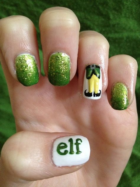 Elf inspired Christmas nail art. This wonderful looking gradient nail art using glitter polish. For more effect you can add a drawing of elf feet and the word elf to emphasize the character.
