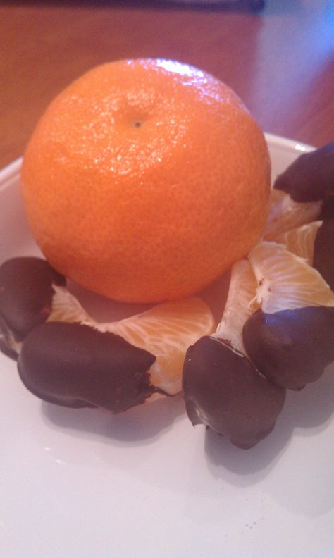 Easy and healthy dessert!  Bust open a clementine and divide up the segments.  Microwave dark chocolate morsels in a glass bowl on 50% power for 1 minute, stir, then microwave in 15 second intervals, stirring between each, until chocolate is liquid and smooth.  Dip segments in chocolate, set on wax paper and refrigerate for about 10 minutes. Add a pinch of sea salt while chocolate is wet, for a salty twist.  Voila! Healthy sweet snack, quick as that!
