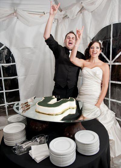 University of South Florida Themed Wedding - Cutting the Wedding Cake #footballwedding
