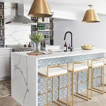 Gold Metal Stools At White And Blue Tiled Kitchen Island Transitional Kitche Mediterranean Kitchen Design Mediterranean Home Decor Mediterranean Kitchen