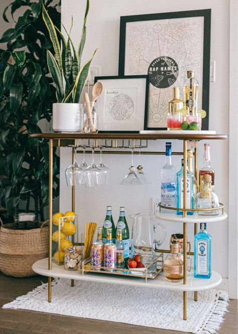 Brooklyn Apartment // Bar Cart Styling Three key elements to styling a functional and chic bar cart! Mid-Century modern decor, colorful, apartment living, NYC.... #homedecor #interiordecorating #barcartstyling #barcart #westelm #westelmbarcart #betterhomesandgardens #home #apartment #nycapartment #brooklynapartment #bloggerstyle #bloggerhomeinspo #interiordesign #interiorinspo #bloggerhome #apartmentstyle #smallspace #midcenturymodern #modernhome #baracces #apartmentdecor