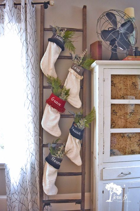 Repurpose an old wood ladder into a fun Christmas stockings display. Refresh and Repurpose an old wood ladder into a fun Christmas stockings display with these easy tips. Winter Christmas, Christmas Home, Christmas In The Country, Christmas Mantles, Christmas Fireplace, All Things Christmas, Christmas Stocking Holders, Diy Stocking Holder, Christmas Crafts