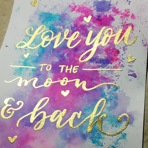 Love you to the moon and back  Embossed gold quote with watercolor background  Loveleigh Loops Calligraphy (@loveleighloops) on Instagram  #watercolorbackground #embossing #cutequote #loveyoutothemoon #watercolorsplatter
