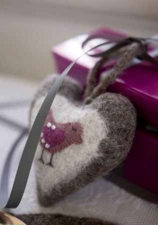 felted heart on wool pillow.wool bird and beaded wings