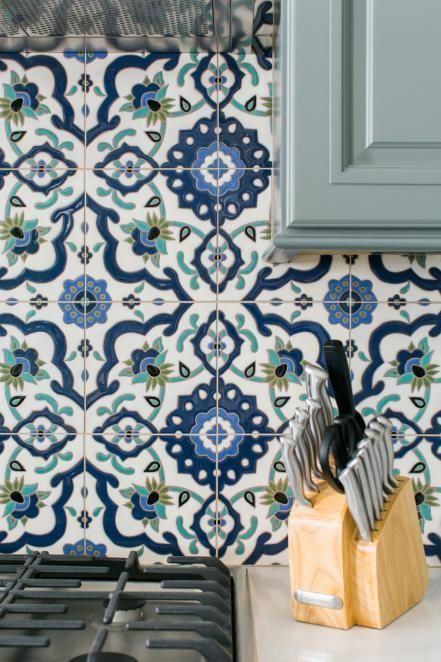 An Artful Backsplash Includes Hand Painted Blue Green And White
