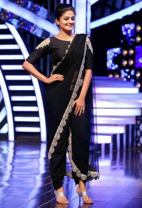 Priyamani in black silver embroidered dhothi saree. #pranaah