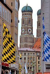 Somewhere in germany i want to go. The Munich flag, the Bavarian flag and the Frauenkirche a Lutheran church in Dresden, Germany Photo by Bob Tubbs.