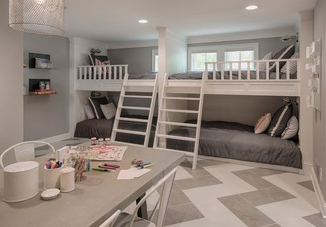 Basement bunk room and craft room area. Chevron flooring is ceramic tile. Grey…