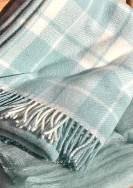 A cream and pale blue plaid blanket to chase away winter's chill.