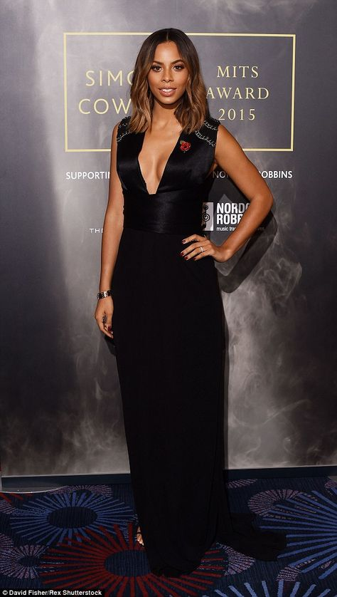 Glam gown: Xtra Factor presenter Rochelle Humes donned a daring, low-cut black gown for the event
