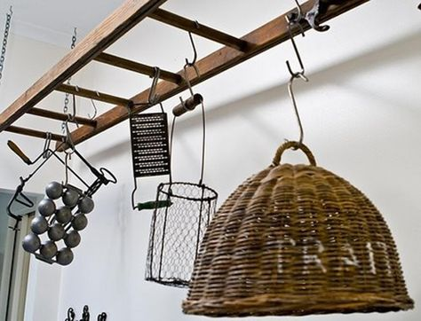 Hold onto your secondhand old ladder, it  can come in useful as a overhead storage unit.