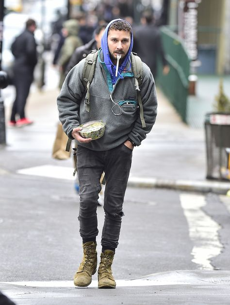 10 Stylish Men Who DGAF What Anyone Thinks Street style military grunge look , shai wearing special field boots paired with distressed jeans, military backpack and hoody