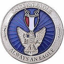 """Redesigned for today's Eagle Scout, this new recognition coin can be used to reward Scouting's highest achievement.   Front of coin features the Eagle Scout medal atop a translucent-blue starburst background with """"Once an Eagle, Always an Eagle"""""""