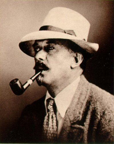 Aleister Crowley with the pipe