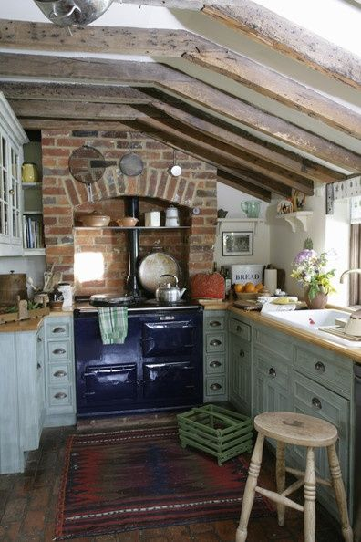 Cozy Kitchen Love The Blue Old Fashioned Stove Nested In To The Brick All And The Wood Beams Brick Wall Kitchen Country Kitchen Home Kitchens