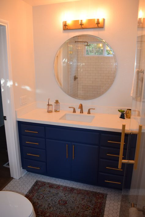 Blue Vanity With Brushed Gold Hardware And Fixtures