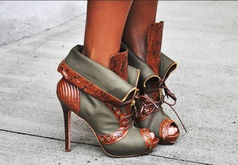 Alexander McQueen cuffed lace up ankle boots.