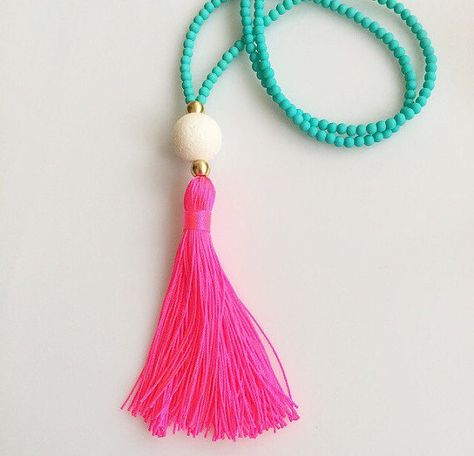 Pink and Turquoise Tassel Necklace. Long Beaded Necklace. Turquoise necklace. Neon Pink Tassel Necklace. Summer Necklace. Gift for her  This summers MUST HAVE necklace!!Turquoise matt beads, white sponge coral round bead and a neon pink tassel!!  You can wear it everyday and it is perfect with your bikini!!  Also available in other colours!!Just send me a message so we can make your preferred combination!!  Visit my shop for more little things ♥ ♥ ♥…
