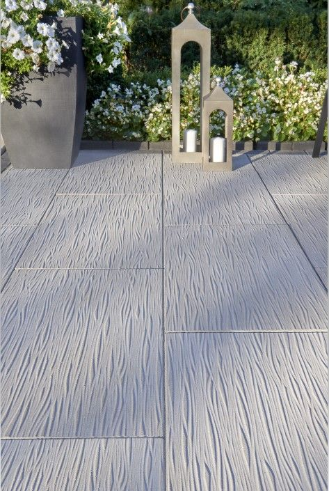 This Backyard Landscape Design Is Inspired By Our Ocean Grande Patio Slab The Ocean Texture Is A First Backyard Landscaping Patio Slabs Backyard Patio Designs
