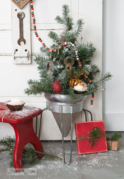 Faux to real mini Christmas tree in a strainer / wood present
