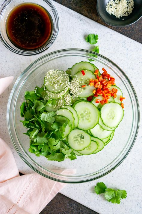Asian Cucumber Salad is a quick and easy snack or side dish. It's refreshing, zesty, and delicious! You can whip it up in just a few minutes. #asiansalad #asiancucumbersalad #cucumbersalad #saladrecipes #asiansaladrecipe