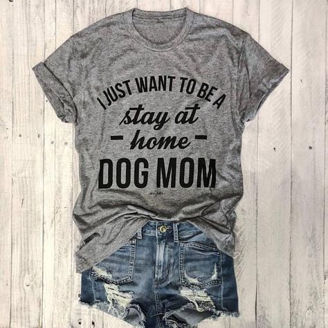 "If you love our graphic tees, then you're going to adore the ""Stay At Home Dog Mom T-Shirt""! This simple top grabs your attention with the amusing phrase printed on front. It features a crew neck and short sleeves and is the perfect go-to piece for layering under practically anything! Shirts fit a little bit small so you might consider ordering one size larger than normal for optimal fit! Pair it with distressed skinny jeans or shorts for a perfectly trendy look! It's sooooo SOFT and comfortable Dog Mom Shirt, Mom Shirts, T Shirts For Women, Dog T Shirts, Trendy T Shirts, Stay At Home, Distressed Skinny Jeans, Fasion, Shirt Designs"