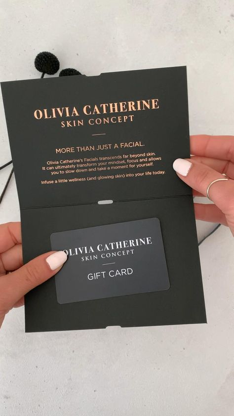 Gift voucher or gift card design black with clear foil on front.