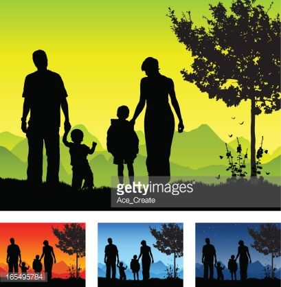 Young Family Of Four Are Walking In Silhouette In A Beautiful
