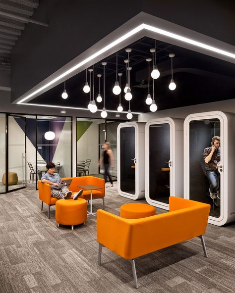 Casual meeting space & telephone booths for privacy at the Slate Magazine offices in NYC.