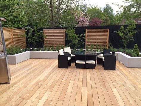 Garapa Decking And Cedar Screens Create Modern Family Garden