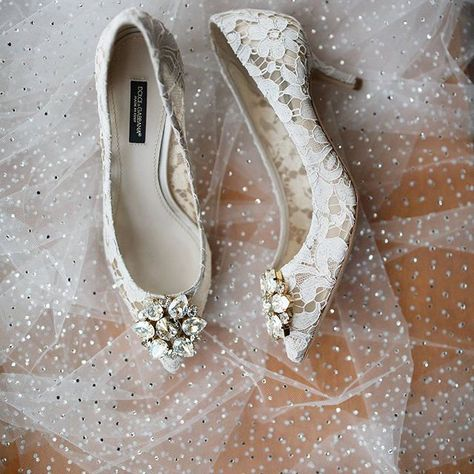 3d68979caf85 Thousands and thousands of handset Swarovski crystals glittering on a  custom designed veil - so fab with our bride s Dolce   Gabbana bridal shoes!